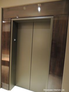 Condo Lobby Pictures | We also used an electrostatic paint system to refinish the elevator ...
