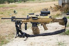 A new HK LMG, the HK121 is pictured here with an adjustable stock and ELCAN sight.