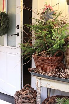 Vintage aluminium tray hold small tree adorned with branches and a star, set in a basket and surrounded by pinecones. This would be great outdoors or indoors.  Weigh it down (maybe with rocks) if outdoors so it doesn't get windblown, even if you set in in a covered area.