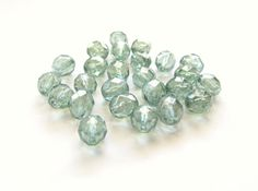 Prairie Green Czech Firepolished Glass Round by TheDutchTulip (Craft Supplies & Tools, Jewelry & Beading Supplies, Beads, Round & Ball Beads, pastel, faceted, round, firepolished, Czech, 8mm, transparent, green, erinite, prairie green, luster, glossy, silver)