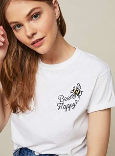 'Bee Happy' Embroidered T-Shirt - - 'Bee Happy' Embroidered T-Shirt Short sleeve white t-shirt with embroidery 'Bee Happy' writing. Converse Noir, Diy Clothes Jeans, T-shirt Broderie, Printed Shirts, Tee Shirts, T Shirt Painting, Aesthetic Shirts, Embroidered Clothes, Bee Happy