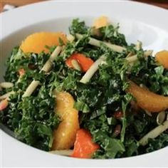 Chef John's Raw Kale Salad Allrecipes.com- 1/4 cup rice vinegar      1 tablespoon orange juice      1 teaspoon Dijon mustard      1 teaspoon grated orange zest      1 teaspoon ground cumin      1/4 teaspoon red pepper flakes      1/3 cup olive oil      salt and ground black pepper to taste      1 bunch kale      1 persimmon, sliced      1 apple, cut into matchsticks      2 orange, peeled and cut into segments (see footnote)      1/4 cup chopped pistachio nuts