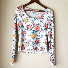 Soft Floral Print Top Super cute floral print long sleeve shirt. Super soft, almost like a really light sweater. Very comfy. Has a slightly cropped fit. Great for summer nights or fall days 😊 Size M but fits more like a S in my opinion. Perfect condition.  Measurements: Condition: Brand new, never worn  🚫Trades  Please ask any questions prior to purchasing. All sales final. Tops Tees - Long Sleeve