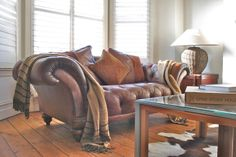 Tetrad deep buttoned vintaged tan leather chesterfield sofa from spacialise.com