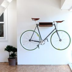 11 Space-Saving Indoor Bike Storage Solutions - - From super sturdy ceiling hooks to surprisingly chic floor stands, here are 11 bicycle storage solutions that will work in any size of home—no U-lock necessary. Bicycle Storage Rack, Outdoor Bike Storage, Indoor Bike Rack, Bicycle Rack, Bike Wall Storage, Bicycle Shop, Apartment Therapy, Apartment Ideas, Harlem Apartment