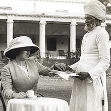 What a great hat and neckline - note the position to forehead. Note high waist on Indian man's wraps.