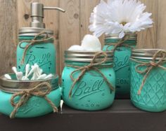 a DIY project for my bathroom for sure! Can also be bought on Etsy! Hand Painted Mason Jar Bathroom Set Mason by MidnightOwlCandleCo Mason Jar Projects, Mason Jar Crafts, Mason Jar Diy, Mason Jar Bathroom, Bathroom Sets, Bathroom Bin, Deco Cool, Mason Jar Soap Dispenser, Painted Mason Jars