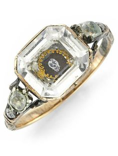 An Antique Rock Crystal and Enamel 'Memento Mori' Skull Ring, 19th Century.