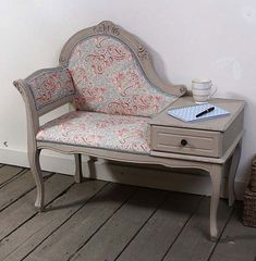I love this phone table. I would refinish it and change the fabric but it would be awesome in a foyer.