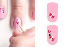 """Paint your entire nail with Candyland. On the bottom of your nail, create two white dots of polish, then apply two red dots opposite of them, so they make a cluster shape.     While the dots are still wet, use a toothpick to swirl them around until you create a two-toned blossom. Use Bad Romance to paint a tapered """"leaf"""" on the largest rose, then dip another toothpick in White Wedding and create a thin line in the center of the black leaf."""