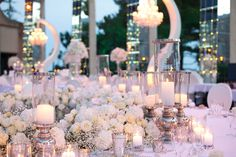 Mix of high and low centerpieces, don't forget about candles, it adds so much to the mood in the evening... Wedding by Monte-Carlo Weddings.