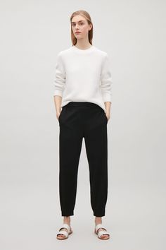 COS image 1 of Elastic waist & cuff trousers in Black