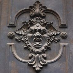 Milan has an incredible array of doors with fascinating details. This alarming looking guy is from the Brera area. Milan City, Fascinator, Door Handles, Lion Sculpture, Guy, The Incredibles, Doors, Statue, Photo And Video