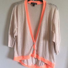 Tan cardigan with neon accents This cardigan is an cream color with bright orange trim. It is sheer and the bottoms of the sleeves are fitted. Size large. living doll Tops