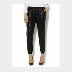 Sequin front joggers Black sequins on front.  Back is solid black fabric. Elastic waist. Two front pockets. Elastic bands at ankles. Brand new plus size from wetseal. Not lined Wet Seal Pants Track Pants & Joggers