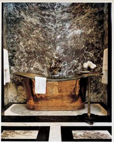 Slab stone focal point, not the tub-also could mask tub with continuation of same slab.