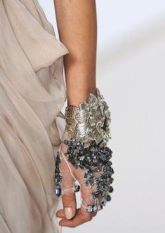 Bracelet/glove combo - incl. longer past elbow in Queen's motifs.