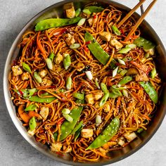 The best Vegan Vegetable Lo Mein recipe filled with crispy tofu, tons of vegetables, and an easy 5 ingredient stir-fry sauce! Chicken Pasta Recipes, Tofu Recipes, Sauce Recipes, Asian Recipes, Vegetarian Recipes, Cooking Recipes, Ethnic Recipes, Chinese Recipes, Vegan Meals