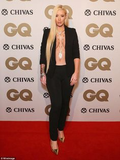 Taking the attention away from the men! Iggy Azalea goes BRALESS at the 2016 GQ Men Of The Year awards... as Natasha Oakley and Devin Brugman slip into plunging dresses
