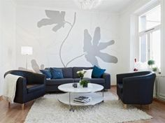 Living Room. Interesting Minuscule Living Room Designs With Relish: Small Living Room Design With Floral Wallpaper Fur Rug Feels Comfortable With The Two Types Of Puffy Sofas And Leather Sofas ~ wegli