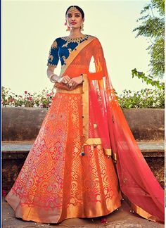 Give in to the colourful confluence of today and tomorrow in this stunning orange and pink banarasi silk lehenga choli. This lehenga choli is decorated with patch border work and embroidery work. Comes with matching choli and dupatta. Choli Designs, Lehenga Designs, Indian Bridal Wear, Indian Wedding Outfits, Indian Outfits, Banarasi Lehenga, Ghagra Choli, Patiala Salwar, Anarkali
