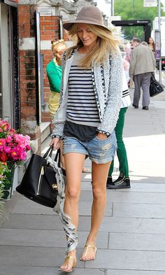 Hats Off: The Best Celebrity Toppers - Poppy Delevingne dresses up denim shorts with louche layers, her elegant Mulberry Willow bag and a taupe topper for a casual weekend look.