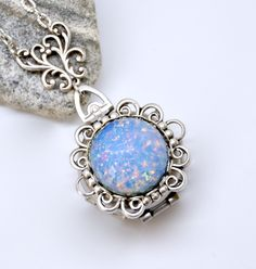 Blue Opal Locket Necklace, Silver 4 Picture Locket, Antique Silver Opal Necklace, 4 Photo Locket, Four Way Locket, Blue Necklace, Filigree by SimpleSoulStudios on Etsy https://www.etsy.com/listing/493114655/blue-opal-locket-necklace-silver-4