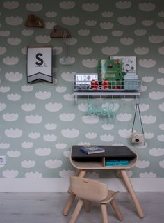 The cute desk and matching chair are from PlanToys. Sweet wallpaper amps up the charm of any kid's room like this one from ferm LIVING.