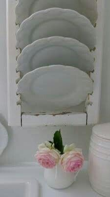 vintage shutter with slats removed to use as a plate hanger