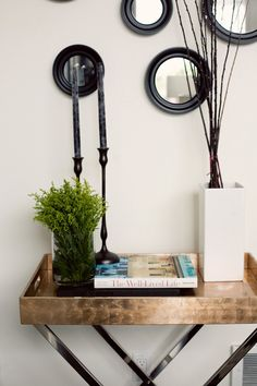 Inspiring simplicity from the home of Erin Hiemstra and Chris Wick. The black candles in black candlesticks take it to the clean goth level that I not-so-secretly adore. Pinned from design*sponge. Butler Tray, Circular Mirror, Interior Decorating, Interior Design, Decorating Tips, Black Candles, Round Mirrors, Circle Mirrors, My Living Room