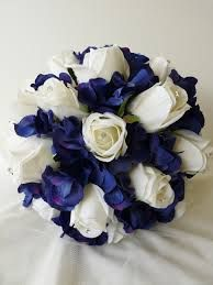 Barbara Bridal Posy Featuring Warm White Roses With Midnight Blue Hydrangea All The Have Diamante Inserted Into Centres