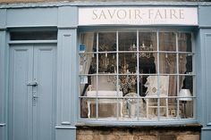 I've always loved this French slate blue against off-white.  What a gorgeous place to window shop.  -- Eve.