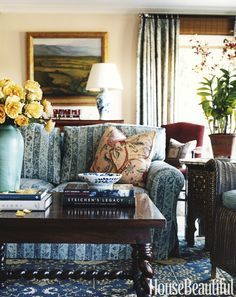 """Designer Michael S. Smith used a mix of patterns in this family room to keep it cozy. """"I think you can be comfortable in a room that has no pattern, but it requires more effort,"""" he says. """"I think pattern is a shortcut to emotion. It has all these memories, of a place or a period or a particular dress your mother wore."""" - HouseBeautiful.com"""