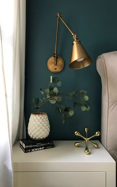 this light fixture just started it all. saw it, fell in love, tried to imagine what would complement it. and here we go with soften teal walls and brass accents