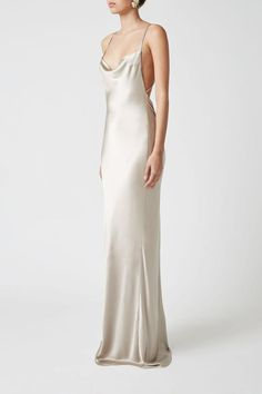 Heavy silk satin cascades down the lines of the body in one elegant movement, skimming curves and smoothing over any imperfections. Cream Wedding Dresses, Slip Wedding Dress, Bridesmaid Dresses, Prom Dresses, Formal Dresses, Bridesmaids, Silver Grey Dress, White Satin Dress, Homecoming Outfits