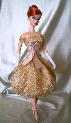 Magique is a very pretty dress on the red-haired Barbie