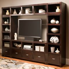 """Sleek, unique and sophisticated, this Lakewood 4-piece wall unit with 60"""" TV console will make the perfect addition to your contemporary media room. Its attractive design features a sangria finish, nickel hardware and scalloped front edges for a striking modern look with a hint of classic style."""