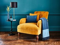 The Wishford design is inspired by the classic Chesterfield but updated with more contemporary lines and detailing. This statement armchair showcases British craftsmanship methods, from the deep-diamond detailing and hand-pleated arms to the beautiful spr Mustard Living Rooms, Fresh Living Room, Teal Living Rooms, Living Room Orange, Living Room Chairs, Living Room Designs, Living Room Decor, Teal Rooms, Dining Chairs