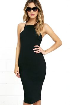 Looking for the quintessential little black dress? Look no further than the Elliatt Cheryl Black Bodycon Midi Dress! An apron neckline with straps that crisscross at back top this super strechy knit LBD. Notched, princess-seamed bodice flows down to a figure-skimming midi skirt. Slit at back. Hidden side zipper.