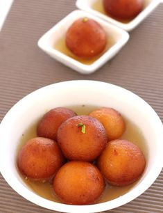 Soft, spongy and melt in mouth gulab jamuns drenched in syrup is a traditional homemade sweet. This recipe uses khoya and saffron flavored syrup for more rich and delighting taste, texture and flavor.