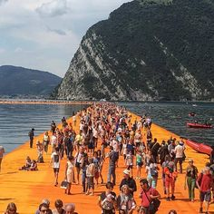 """Installation by the artist Christo, """"The Floating Piers,"""" consists of temporary bridges spanning Italy's Lake Iseo from June 18th till July 3rd 2016 - Source: Platform AD FB page"""
