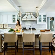 """Now the family spends most of their time in the airy space. """"Andrew truly opened it up, and the flow is excellent,"""" the homeowners say."""