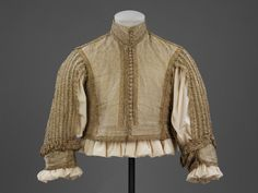 """1650-1665 English Doublet at the Victoria and Albert Museum, London - From the curators' comments: """" From 1650 to 1665, doublets shortened so that there was a gap between doublet and breeches through which the shirt could be seen. The centre back and front sleeves were left unstitched for further exposure of the shirt, which in the 17th century was considered underwear. More conservative members of society considered the result rather untidy looking."""""""