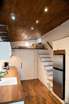 Tiny house with lofted sleeping area over the kitchen.