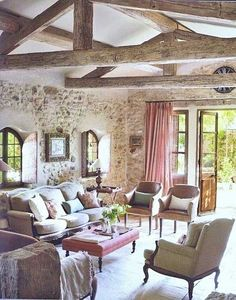 totally neutral room. brick, stone, beams and then just a hint of raspberry/rose.