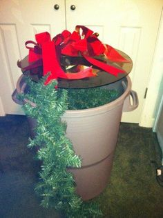 Have a bunch of garland or outdoor Christmas decor? Try storing in a clean trash bin!