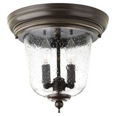 """Showcasing a seeded glass shade and antique bronze finish, this eye-catching flush mount brings chic appeal to your foyer or kitchen.  Product: Flush mountConstruction Material: Metal and glassColor: Clear and antique bronzeFeatures: No transformer required Seeded glassJunction box connectionsAccommodates: (2) 60 Watt candelabra incandescent bulbs - not includedDimensions: 10.25"""" H x 10.65"""" Diameter"""