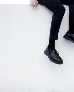 Black shoes white wall