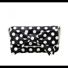 "Betsey Johnson's Fabulous Dotty Cross Body/Clutch Get spotted with this ""eye-catching"" bag by the fabulous Betsey Johnson. This iconic designer always infuses a touch of whimsy into her designs and this adorable polka-dot clutch comes with a shoulder strap.  6.5"" high x 12.5"" wide x 1"" deep ,Diamond quilted faux leather, All over dot pattern,Chain strap is wrapped at top for comfort 11"" drop,Top flap with a magnetic snap closure,Fully lined interior Betsey Johnson Bags Crossbody Bags"