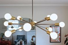 mid century modern sputnik style chandelier // rustic modern brass and unpolished steel exposed edison light bulb lighting
